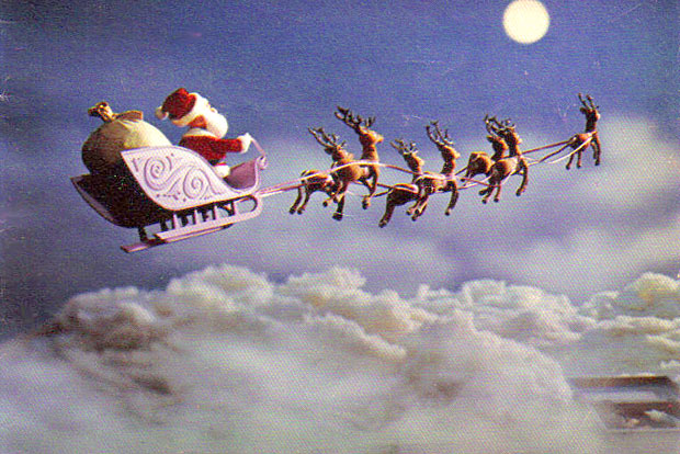 Rudolph the Red Nosed Reindeer sleigh flying through night